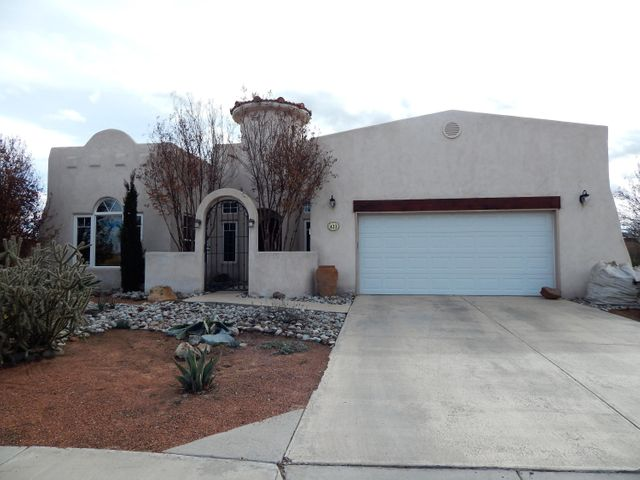 Located in fabulous Las Brisas Del Rio, this beautiful Mediterranean-style home has open & light floor plan with vaulted ceilings and stunning tiled living room with fireplace. With 1,955 sq ft, 4 bedrooms and 2-1/2 baths, you will enjoy the special touches like skylights, custom wood doors, recessed lighting and arched doorways. Split master bedroom with walk-in closet and luxurious bathroom with garden tub. Walled backyard is beautifully landscaped with very large garden area, fruit trees and has a covered patio w/gas stub for BBQ's. Beautiful mountain views from yard. East access to I-25 and minutes to Albuquerque.  Close to all City conveniences!
