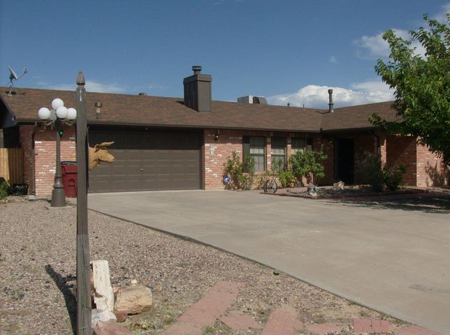 Attractive home in very nice area of Rio Communities. Brick home on .25 acre lot, fenced back yard . Home has been well maintained through the years featuring a large living room with brick fireplace, over sized  kitchen with so much cabinetry , and nice size dining area, garage walks right into the kitchen area, covered back patio is also just off the kitchen & garage. Large master with dressing area & 2 closets.  Satellite wiring in all rooms. Evaporative  cooler and furnace are 2 years old. Water feature in rear yard needs to be resealed before using. Very suitable home for young small family or retirees.