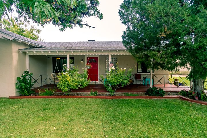Wonderful, comfortable & beautiful - directly across from Monroe Green Park & not far from the greenbelts of Ridgecrest. A very well-maintained 1-level home with original pine floors & a long list of recent updates. Welcoming front porch leads into large living room with fireplace, adjacent den, dining room & remodeled, updated kitchen with cherrywood floors, stainless-steel appliances, wood cabinets, black plate steel counters & penny-round tile backsplash. Three bedrooms + one & one-half baths. Two floor furnaces & four mini-splits. (Evap cooler, too.) Fully fenced yard includes wood deck, patio, & play yard. Gated driveway, detached double garage, storage building and alley access. Roof new in 2018; sewer line new in 2015; thermal windows new in 2014.