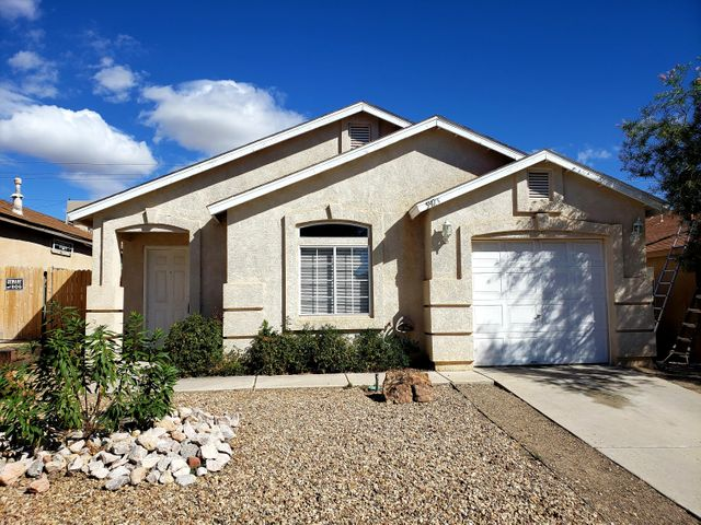 Wow! No time to waste on this hard to find, well cared for move in ready home.  Located in a convenient location in Albuquerque's Paradise Skies Subdivision..  The home has new Bedroom Flooring and tiled flooring.  The Floor plan features a Living Room, Eat In Kitchen, Two Bedrooms and a Bathroom. Seller has just replaced the Water Heater plus two of the Ceiling Fans.   The spacious backyard has a nice dog run that will convey.  The washer, dryer, and fridge will convey in As Is condition with no warranty or guarantee as to remaining life.  This is a very cute home and ready for a New Owner!