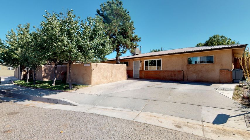 Charming home filled with character in the heart of the north valley. This home sits in a quiet cul-de-sac and features 4 bedrooms, 2 bathrooms, and 2 living areas. Enjoy the outdoors relaxing in the front courtyard or entertaining in the large backyard. Ring doorbell and all appliances stay! Conveniently located with easy access to Paseo Del Norte and Montano.
