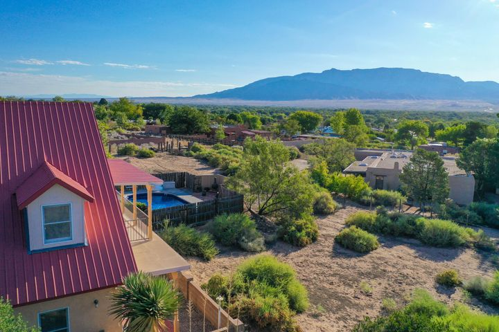 Open House Sunday 10/27 2-4pm.  Don't miss this Corrales horse property with stunning Mountain Views!! Come check out your new home, today! As you visit this home, you'll be happy to find that there are two master bedrooms one upstairs, and one downstairs that both offer patio access so you can enjoy the view day or night. There are two living areas as well as a beautifully updated kitchen where you'll be sure to cook up lots of treasured memories! As you step outside, this home gets even better with room for Horses, Stables & Tack Room.  Wonderful pool where you can cool off and unwind after a long day at work! Truly a must see Home, Schedule a Showing Today before your new home is someone elses!