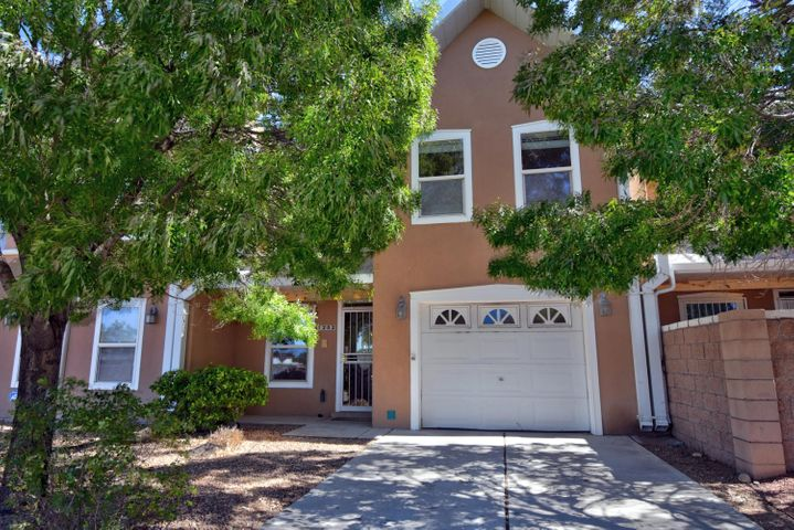 Darling townhouse with wonderful floor plan located  minutes from Nob Hill, UNM, Kirtland Air Force Base, Downtown, Hospitals, and Michael Thomas Coffee is a block away!  Kitchen has lots of storage, granite counters with under counter lighting, walk-in pantry, gas range, island bar with seating.  Kitchen opens to dining room and great room with soaring T&G ceilings, beautiful gas log fireplace.  Downstairs bedroom and 3/4 bath are perfect for an additional guest room. Upstairs there are 2 additional guest rooms and full bath with granite counters. Large master with flex area could be study/office/exercise room, full bath with separate jetted tub, walk-in shower double sinks. East facing backyard with covered patio great for BBQ.  Home was been well cared for and ready for new owner!