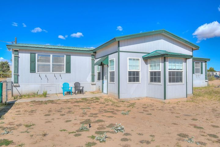 If you are looking for space and lots of updates, this home is for you.  Located in Los Chavez, this home sits on over an acre of land and is enclosed with a pipe fence.  A 13x19 enclosed sunroom/porch is not included in square footage.  New refrigerated air conditioning.  Yard features a detached 2 car garage, two separate car ports, a storage shed and play house.  Front yard can be easily maintained with the sprinkler system.  The school bus pick-up for all Belen Public Schools grades Elementary, Middle School and High School at the end of the road on Mustang Way and Cuatro Vientos, where the dirt road ends.