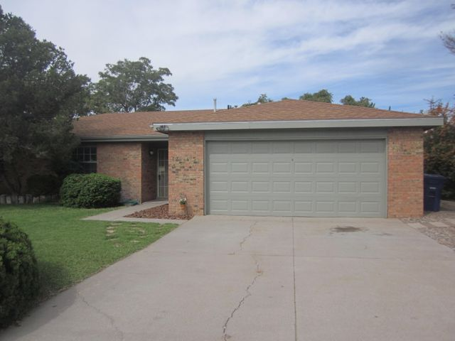 OPEN SUNDAY 1 to 3 pm.  For the family that wants a clean, affordable 4 BR home in a nice, established NE neighborhood.  Just a few blocks NW of Abq Academy.  Close to shopping, post office, churches, & eateries.  Easy access to I-25, too.  BUYER CLOSING COST HELP AVBLE.  This home features large bedrooms, big living/dining combo room, plus spacious family room with brick fireplace.  Recent carpet, tile, water heater, & roof.   NEW DOUBLE PANE ENERGY STAR WINDOWS SOON.  Finished 22' x 22' garage with built in storage shelves & side access door.  Grass lawns, trees, & shady covered back patio.   Full home & pest inspections done.  Minor cosmetics still in progress.   Ask about existing transferrable home warranty.   Fast closing & possession possible.  Be settled before the holidays. Sweet!