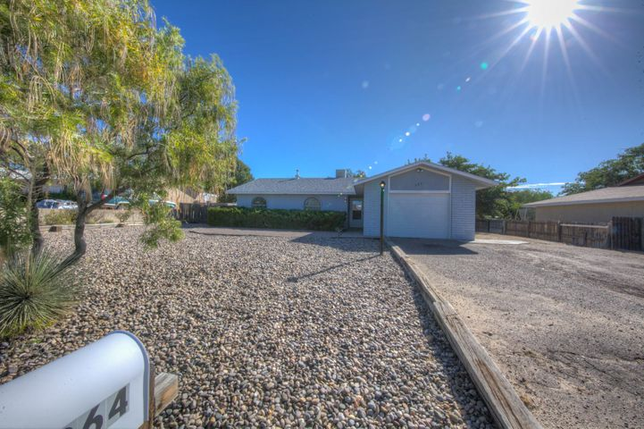 Great starter home in desirable Rio Rancho. Newer roof,fresh paint. enjoy this open light and bright floor plan with cozy fireplace. No carpet to bother with. 3 spacious bedrooms. Large back yard with possible easy back yard access. Has fantastic back yard with grass and covered patio.