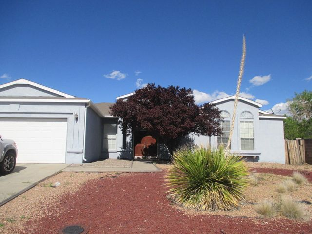 Back on the market. Buyer had trouble with financing. Inspections are done. Located in Rio Rancho this 4 Bedroom , 2 Bath, 2 car garage, 1 story home features  Large great room with newer carpet,  a spacious master bedroom , Master Bath has dual vanities and separate tub and shower. Located on HUGE 1/2 acre lot with backyard access and stunning views.  Home was just been re-piped.