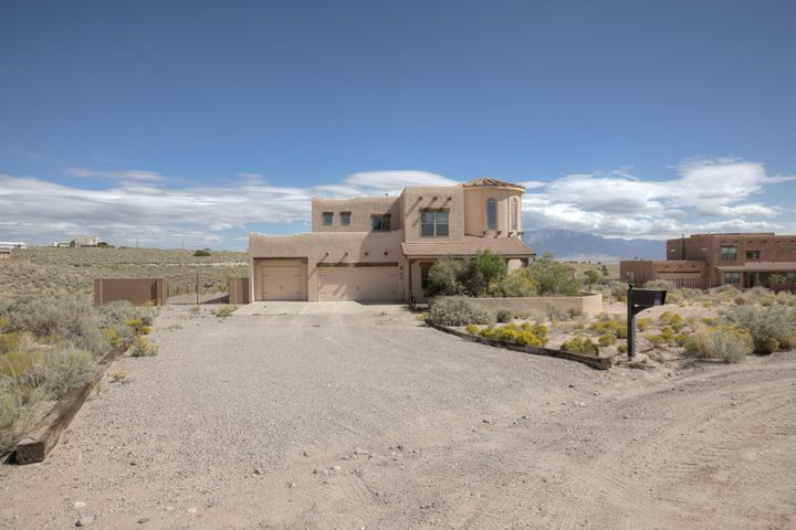 Incredible custom home situated on approx. 1.22 acre lot with Majestic views of the Sandias.  If you crave  privacy and a peaceful setting with all the ameniites this home is for you!! Awesome floor plan with grand entry Frml. Dining, gourmet  kitchen w/ breakfast nook. Kitchen is  open to the great room complete w/  soaring ceilings, clerestory windows, and a Den  area/bar/ library space with breathtaking views.  Powder bath and Luxurious Master suite w/ adjoinging bath w/ his and hers vanities, garden tub and seperate shower all on the main floor. Upper area complete w/  Loft , 3 bdrms.  one full bath  and one 1 3/4 bath. 2 bedrooms share the full Jack  and Jill bath . Incredible views . awesome light & bright rooms.  Storage galore , large rooms , seperate laundry area, 3 &car garage.