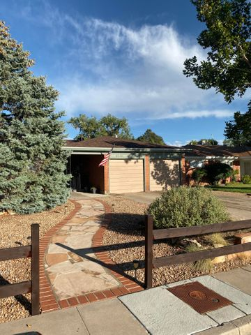 Inspections Completed. Beautiful home within walking distance to Sandia High school. Lush mature landscaping at front of home. Updates to home include: Roof replaced in 2018 with Transferable Warranty, Master Cool air conditioner in 2018, Kitchen remodel in 2017, bathrooms and windows redone in 2010. You will love the spacious floor plan and Original Hardwood floors! Two living areas perfect for relaxing. Huge yard ready for your finishing touch! Don't miss out out on this great home!