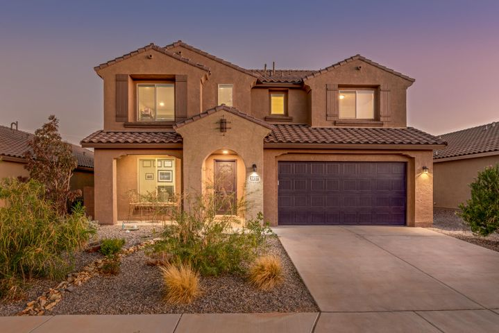 ***Open House 11/17 from 11-1PM*** A must see! This beautiful Pulte built home in Lomas Encantadas offers 4 bedrooms, 4 bathrooms and an incredible view. Open kitchen with stainless steel appliance package, walk-in pantry and a large island looks out over the main living area featuring a floor to ceiling stacked, stone gas log fireplace. Two master bedrooms, one downstairs and another upstairs helps this home meet many diverse needs. Backyard with heated pool and hot tub combo is ideal for entertaining and relaxing while looking out onto the stunning Sandia Mountains. VA mortgage is assumable at 3.73% for Vets!!