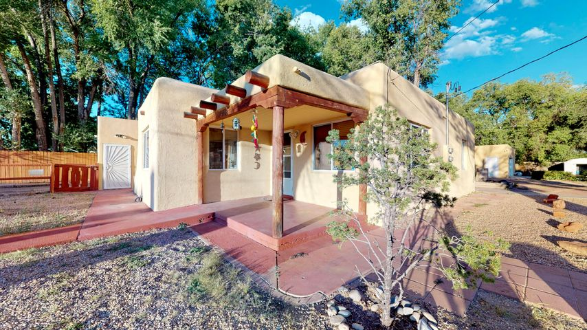 North Valley Charm! Easy To Show.  WOW!! 2 Homes on One Large .53 Acre Lot, 4+ Car Garage.  Main house 1691 sqft, 3 bedrooms/1 bath, Casita/Guest house 1326 sqft, 2 bedrooms/1 bath 2 Living Rooms. Quiet & private, the last property on East side of dead end street. Both homes sit on over a half acre. North property line backs up to lush, Green Los Arboles. The Main home has wood floors throughout much of the common areas & Casita has skylights and stained concrete floors. 4+ Car garage AND 2 car garage can serve as a fabulous studio spaces, workshops for crafter/artist's... Also 3 separate storage sheds. Close to Big I, Old Town, Downtown, Schools, Park, Bosque, La Montanita Co-op, Indian Pueblo Cultural Center, Starbucks, Laguna Burger and much more...