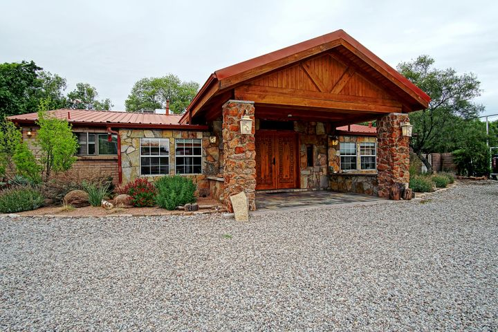Style Ranch home located in the  North Valley! Horse lovers dream!UPDATED 648 sq ft Casita located on this lovely estate which has 1 bedroom, 1 bath, kitchen and living area (not in MLS house sq ft). The main home has granite counter tops, SS appliances with beautiful hickory cabinets. Family Room has travertine floors and stone fireplace for those chilly valley nights! Game room has marble floors, 18' T&G pine ceiling with gas stove. Large Owners Suite that has dble vanity,jetted tub,sep shower! 3 good size bdrm. Very delightful water feature with Koi. RV Parking & hookup, 4 car garage for the car enthusiasts. Lighted for night use Horse facility w/2 stalls & covered storage areas for 300 bales of hay! Two pastures, 4 rail steel pipe coral fences.A must to see!