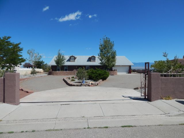 Gorgeous home on a full acre with breathtaking panoramic views!  This home sits on the West Mesa Bluffs in an exclusive community of custom homes.  Features include 2 living areas and a beautiful ceramic tile & wood flooring throughout. Big 4th bedroom could be a game room or office.  Large country kitchen with Avonite counter tops, breakfast bar & large center island. Fabulous formal dining room with wet bar is great for entertaining. Master Suite is spacious with French doors leading to covered patio. Master bath with spa jetted tub & separate shower. Relax or entertain on the huge covered patio & front courtyard. Metal roof, refrigerated air, security system, new carpet. Come see this unique custom home today!