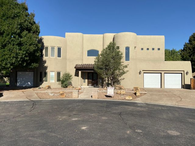 Welcome Home! This quiet gated community off of the prestigious Rio Grande is something spectacular. Everything is NEW NEW NEW from the outside in. Synthetic stucco, new landscape, garage doors, interior and exterior lighting, gorgeous flooring throughout, a new exquisite kitchen for any chef that will have you feeling like you're in your very own restaurant with your new appliance package, a giant media room fit for a movie theater or a second master bedroom, new tile and plumbing fixtures in all the bathrooms. This is a must see!