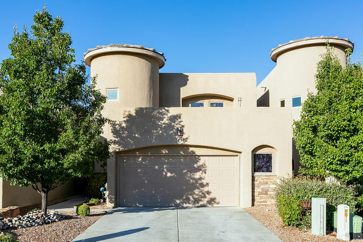 Private Gated community w/ City & Mountain Views! Juan Tabo & Spain location = awesome schools!  Move-In Ready 4 Br + office, 3.5 Ba, finished 2 car garage & Private back yard oasis!  Owners suite downstairs & includes a spacious bath, separate jetted tub, shower & a large walk-in closet. Upstairs features a separate door to the balcony for guests; 2 Br's w/ a Jack & Jill bath plus an additional Br w/ a 3/4 Ba & it's own door to the balcony. Plus the office is upstairs with Mountain Views! The kitchen invites you to stay AND includes stainless steel appliances, island w/ storage & electricity, breakfast bar, gorgeous granite counter tops, young double oven/stove w/ convection & 5 burner gas cook top. An abundance of walking, hiking and nature trails near this NE Hgts Beauty! Priced to Sell
