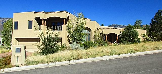High Desert neighborhood. Mountain and City views  Tuscan Style Home. Tile Floors. Master Suite on main level. Upper Level features 2 Bedrooms, Family Room with full bath. Covered backyard patio, this home sits on approximate .56 acre . Priced to sell