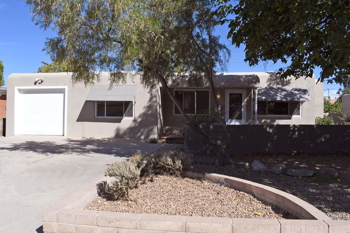 Great location. Very close to Sandia labs and easy access to I40. Fully remodeled. Gorgeous wood floors have been refinished. Fresh paint, new tile floors. Remodeled kitchen& both bathrooms. The kitchen has been updated with new cabinets, granite counter, new dishwasher gas stove, exhaust vent over the stove. The washer dryer and refrigerator are not new and convey AS IS .The bathrooms are completely remolded w/all new fixtures and snappy tile. Brand new heat  A/C.  and hot water heater. The house has lots of possibilities. It is polished and ready to move into. The BY has access to an alley a possible Shop could be built.This is worth showing your clients. There is a little clean up in progress and will be completed soon. Illness slowed us down. Brand new roof.