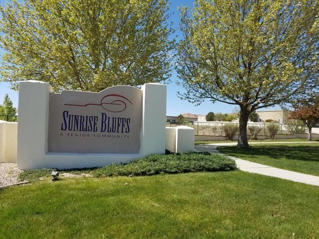 Move in ready home in the 55+Community of Sunrise Bluffs!!  Welcome to this quiet gated community in Belen!  This home has 3BR's, 2BA's, 2CG and is about 1300SF!  All appliances stay including Refrigerator and Washer and Dryer!  There is a nice covered patio and lovely garden areas!! Sunrise Bluffs has a clubhouse complete with daily activities and an indoor pool!  There is also  RV parking inside the community for a small monthly fee!  HOA covers the community center, pool, streets and common areas!