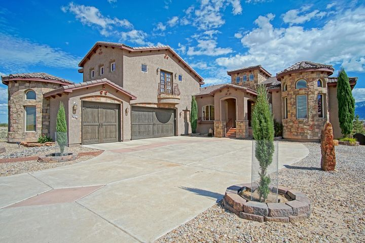 NEW PRICE! ***Gorgeous Tuscan Inspired Estate* Located In Vista Entrada w/ Paved Roads & City Utilities* This Amazing Home Possesses The Most Exceptional VIEWS of the Sandia Mountains* A Resort Like Property on .76 Acres, This Residence Is The Perfect Combination of Living & Entertaining* Spectacular Outdoor Spaces w/ Sparkling Gunite Inground Pool, Hot Tub, Oversized Covered Patio Space, Outdoor Kitchen, BB Court & Putting Green!* Amazing Interior Spaces* Over 5300 Square Ft, 2 Living Areas, 5 Bedrooms, 5 Baths, Private Study/Library & Spacious Theatre! Well Equipped Chef Inspired Gourmet Kitchen* Fully Finished Walk Out Basement w/ Fireplace* Close To Shopping & Major Roads* In The Desirable V Sue Cleveland School District* Owner Financing POSSIBLE - Call For Terms!
