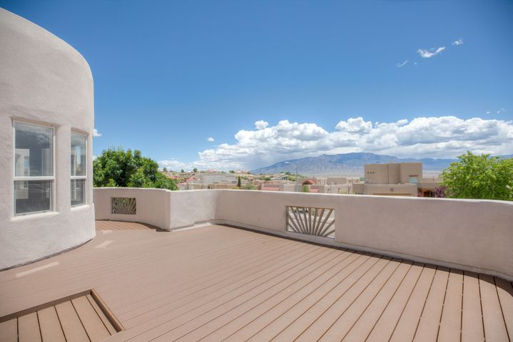This impeccably maintained home situated on the ridge between Rio Rancho and Corrales offers amazing views from the large 20x16 deck above garage. This home has more to offer over others in the area! The most dramatic difference in this home besides the new 20x16 Trex deck is the extended Master Bedroom at 30ftx20ft which offers tons of space for a nice sitting area, or use it as the last owners did as a Yoga/Gym area. This home offers tongue and groove ceilings in living area accented with amazing viga beam, granite in kitchen, and all appliances including washer and dryer stay with home. The front courtyard and back patio will give you plenty of privacy and outdoor living space. If that wasn't enough don't forget to check out the garage measuring at 31'6''x19'8