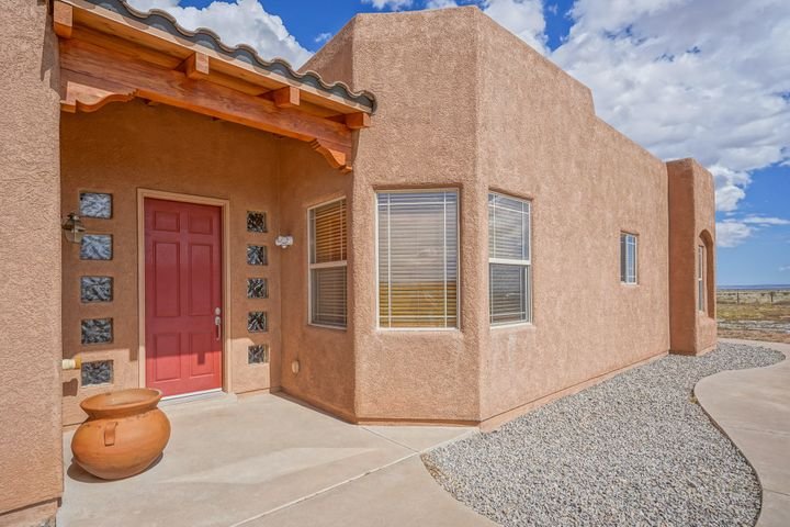 Endless skies with the Custom Pueblo Style Home.  Used as a second home, it's been lived in lightly its 12 years.  Home boasts 3 full baths, 4 bedrooms or 3 with an office/in law bedroom with own bath. Kitchen has granite slab counter tops, large pantry light and bright with a dining attached. Master suite has his & her closets, back patio accents and T&G ceilings with vigas though out more of the home. Storage places galore in this home, and that doesn't even include the detached 2400 sq ft shop/garage/home business, you name it.  Floors have epoxy finish in both shop and attached garage.Tile in all rooms except the bedrooms.  This is a lovey home, just needs your green thumb for landscaping... Completed fenced and gated, bring the pets.