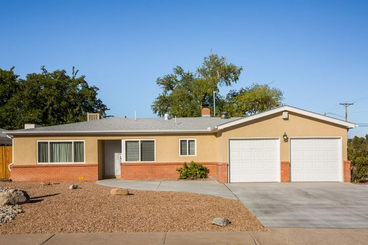 Very open floorplan in the 1960's built home, One of a kind. Sunken den with wood burning corner fireplace. Refinished  Hardwood floors gleam in living room and bedrooms. Mother in Law suite with walk in shower with separate access on side door. Large window from living room with views to the Sandia's.  Corner Lot with RV access. Newly concrete driveway and walkways. Newer windows, A rare find!