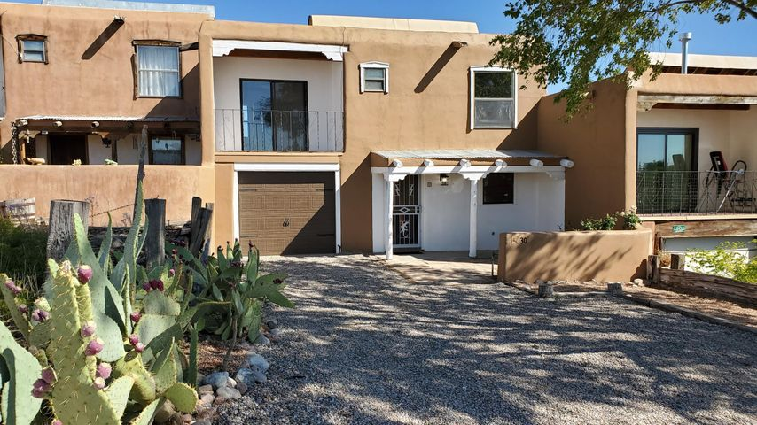Extensive update just completed! A rare opportunity to own in Corrales for this price.  This townhome features classic NM style the wood ceilings, brick floors, kiva fireplace, and Sandia Mountain views. Updates include new... Furnace, Hot Water Heater, Electrical Panel, Electric Outlets and Switches, Paint in and out, Carpet, Gas Range, Dishwasher, Garage door and Opener, Interior Doors, Window Glass, Granite Counter, Cabinet Doors, and more. Come and see before it's gone.