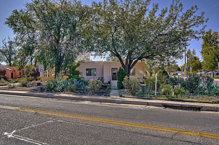 This well cared for home is directly across the street from UNM, with easy walking to UNM Hospital, Nob Hill restaurants, and Monte Vista Elementary too! There are hardwood floors throughout, a small guest house with a full bathroom, a secret garden of a back yard, and a 305 sqft. finished basement that could be an extra bedroom.  Having been been freshly painted and cleaned, this one of a kind home is move in ready.  Also a potential investment property if rented out to students!