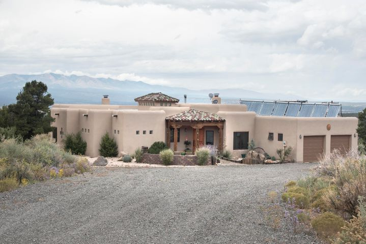 This Deer Canyon Preserve horse property won't disappoint!!  It is situated on a 25 acre lot with remarkable 360 degree views of the Manzano Mountains, quiet & serene living, horse and hiking trails throughout the preserve, and a community club house with state of the art community horse stables.   Home is perfect for entertaining with open floor plan and live in quarters.  The gorgeous country style kitchen has a sky chase sky light, custom cabinetry, granite counters, large island w/ breakfast bar, and stainless steel appliances.  The master suite has direct access to the back patio, beautifully designed  master bath with custom garden tub & walk-in snail shower.  Custom brick floors throughout and wood treatments and vigas in living area.  Schedule a showing today, and call this home!