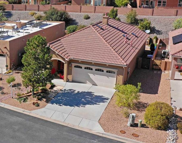 Welcome to Del Webb Alegria. This home boasts wood, tile  & carpeted floors, gas log fireplace, 2 bedrooms, large closets and a TV/Office/Flex space just off the great room. Cherry cabinets & granite counter tops in the kitchen. Finished 2 car garage. That's not all. Step outdoors and you will find an  extended, covered patio with alcove for your grill.  Fully landscaped front/back. Lush plantings/trees and built-in storage. Moving on to the Community amenities you will be happy to know that you can have as much (or little) involvement with your neighbors at the Community Center, walking paths, pool or bocce ball. Conveniences are now just blocks away. Shopping, hotels, great restaurants and less than 5 miles to the Rail Runner which will whisk you to historic Santa Fe (62+ free on Wed.)