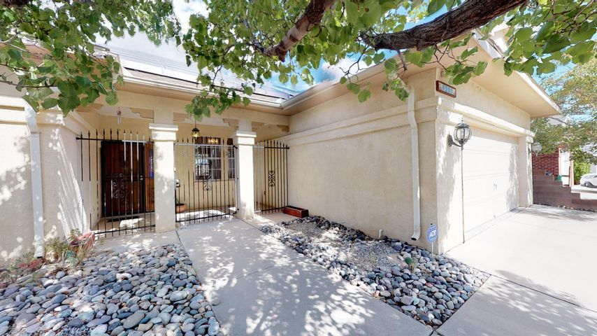 Great location, backs up to open space, nobody can build behind property. Lovingly owned by one couple since it was built in '95, this grand home is perfect for entertaining with 1 covered patio, 1 open patio, and views of the Jemez & Sangre de Cristo Mountains. Outstanding view of July 4 fireworks, too! You can use the 17x24 heated sunroom with new carpet as a 3rd living area! Has Solar!! Move in ready, new luxury plank flooring.  Fresh paint throughout much of home; newer stainless kitchen appliances; new water heater 2019; new evap cooler 2018.  Less than .5m to groceries and fast food!  Check out the master suite w/ huge walk-in closet!   NO POLYBUTYLENE!