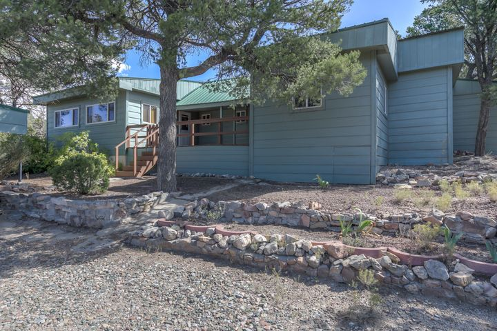 This home is ready for new owners! The front deck offers a cool breeze and beautiful views!! This 2 bedroom home is very spacious and has an open floor plan that is perfect for entertaining. This property offers a newer metal roof, deck, windows, well pump, septic (2017) and electric panel! Come check out this cozy mountain home today!!