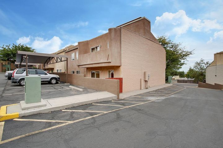 Come enjoy the peaceful MOUNTAIN VIEWS and the CITY LIGHTS in this updated condominium located in a desirable neighborhood at the base of the sandia mountains. Just minutes away from excellent hiking trails, schools and shopping. 2 PRIVATE enclosed courtyards, new floors and new light fixtures throughout really make this one SHINE! Come see for yourself, this one will not last long.