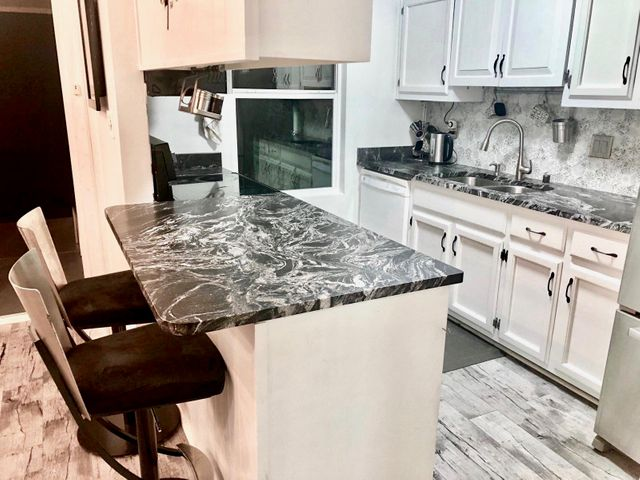 MAJOR PRICE REDUCTION - Remodelled ('18) & Move-in Ready!Amazing Townhome in downtown ABQ w low HOA -close to Hospitals, UNM, Nob Hill, & parks. Easy access to Freeway & ART. Step inside to find NEW flooring (main fl & Baths), panel doors, LED lighting & painting. Updated Kitchen incl SS appliances, marble counters, lights & under cabinet LEDs. Bathroom has new vanity & fixtures.  Enjoy natural light  fr large windows & Sliding Door to BY Oasis - w covered patio & turf - perfect for relaxing/entertaining. 3 Bedrooms upstairs + Full Bath w Jetted Tub, new vanity & fixtures. Relax on the balcony overlooking BY & enjoy NM Sunsets. Oversized 2-car garage w workshop, skylights, b/i shelves & High-End, Insulated (R-17) Garage Door & Opener +Epoxy Floors. Come see this remodelled townhome today