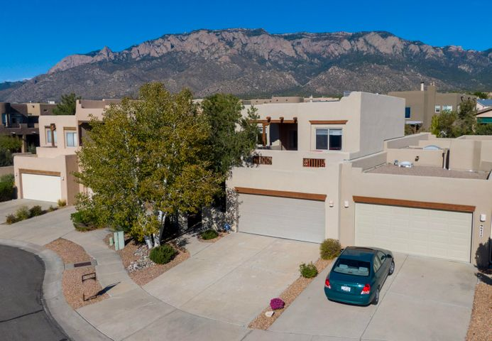 ***Open Houses Sat & Sun from 1-3pm*** Enjoy gorgeous views of the Sandia Mountains and city lights in this custom Tiara townhome nestled in the foothills. Breathtaking views of mountains from upper loft/office space city views from large second-floor deck. The gourmet kitchen offers granite countertops and stainless steel appliances. Along with a great room features 12-foot beamed ceilings and a gas log kiva fireplace;it's perfect for entertaining! Main floor MBR retreat has access to covered back patio leading to a low-maintenance private back yard. Master bath has a jetted garden tub, separate shower, double sinks, and huge walk-in closet. Two additional bedrooms and full bath located on second floor. Oversized windows offer plenty of light throughout. Don't miss out, come see it today!