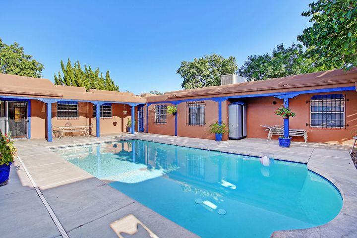 Rare opportunity to own a true adobe home in Dietz Farm area w/brick floors & beamed ceilings.Welcoming courtyard entrance with a private hot tub courtyard.Foyer opens to liv & din areas.Talavera tile accents in kitchen ample counters and cabinets plus two pantries.Attached teen suite or in-law quarters which offers a living area bdrm full bath & kitchenette.Master boasts kiva fireplace and 3/4 bath.Currently using fam rm as master suite w/full bath and a bdrm converted to walkin closet.Two more bdrms and bath.Full size service rm w/ extra storage.Attached two garage in front plus one behind. RV parking area with electric and access to sewer.Relaxing private center courtyard pool plus walled grass and gravel yards.Perfect home for a multigenerational fam,or home office.Versatile floorplan!