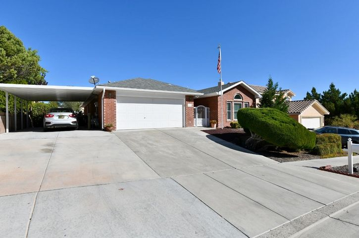 Incredible one story, 3BDR/2BA/2CG plus a 450sf professionally finished sunroom for second living area,/game room/exercise room high up to take advantage of scenic mountain views, pellet stove and mini-split for heating and cooling & two sets of sliding doors to the backyard!  So many updates including windows, tile flooring, refrigerated air/furnace, tankless water heater w/recirc pump, pellet stoves, smart thermostat, water filtration system.  Remodeled kitchen with granite countertops & refinished cabinetry.  Master bdr on its own wing with remodeled bath featuring an oversized shower, double sinks, walk-in closet, raised ceiling.  Beautiful landscaping in the backyard with raised garden, Plum, Apple, Peach trees, elevation is high to capture views of the Sandia Mountains.