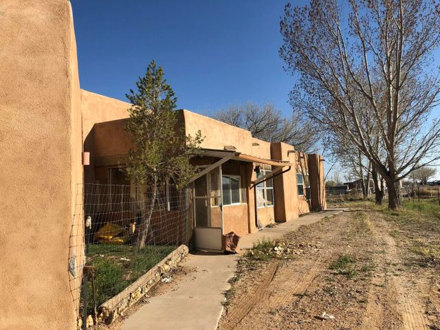 This home is located in a nice secluded farm community with lots of space to roam. The Pueblo Style home includes three nice size bedrooms, two full bathrooms, open country kitchen, and nice open living room. The attached two car garage completes this home. Enjoy the outdoors with this five plus acre parcel of land and breathtaking scenery.