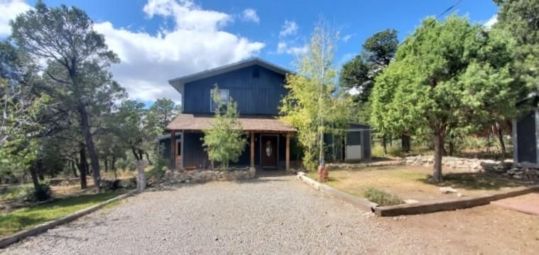 Come take a look at this great home located on a beautiful private landscaped lot.  This home is light and bright with an open kitchen /dinning room, also features a large sun room. This home is located on a fenced/gated lot adjacent to forest and mountains. Come take a look.