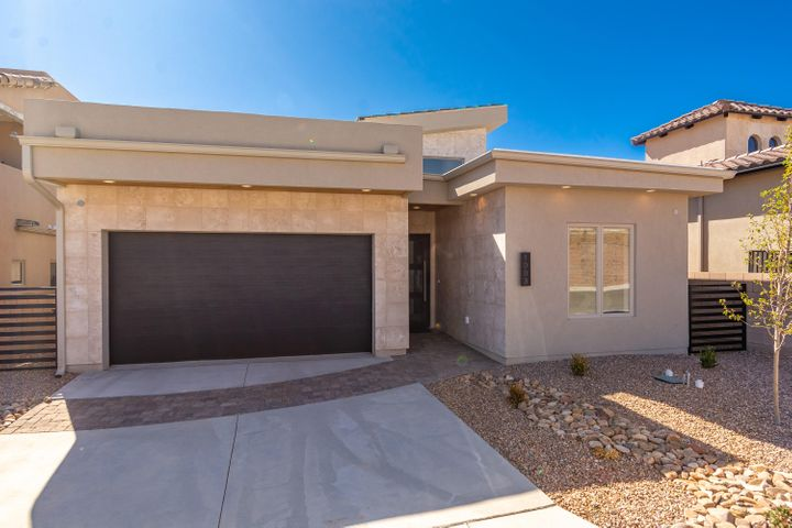 Beautiful Brand new Roku home located in the gated C De Baca community of Bernalillo! Home features 1,580sf with 3 bedrooms, 2 full bathrooms and a 2 car garage! Great bright and open floorplan with plank wall entry, raised ceilings and wood look tile throughout.  Stunning kitchen with custom cabinetry, granite countertops, backsplash, gas range, range hood and refrigerator, large center island with seating and a skylight plus kitchen pantry! Great living space with custom ceiling and recessed lighting.  Master suite with trayed ceiling. Step through the barn door into the grand master bath with dual sinks, custom vanity, free standing tub, walk-in shower with dual heads and a large walk-in closet.  Two additional spacious guest rooms and a beautiful guest bath with all the upgrades!