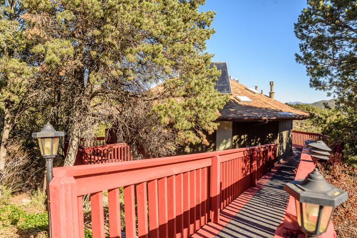 Welcome to Forest Park! What a great place to call home in the sought after Cedar Crest area and close to everything schools, restaurants, banks, grocery store and only 30 minutes or less to ABQ. This home has everything you're looking for a treed lot with amazing views from the wrap around deck. On the deck is your own private hot tub to enjoy those starry nights in the East Mountains and don't forget theres a private deck off the master bedroom. The recent updates include new hardwood floors, carpet and vinyl and fresh paint. There are two living areas one upstairs and one downstairs and each has a gas log fireplace to cozy up to during the winter months. There is a detached two car garage and a storage shed on the property. This home won't last long call and schedule a showing today.