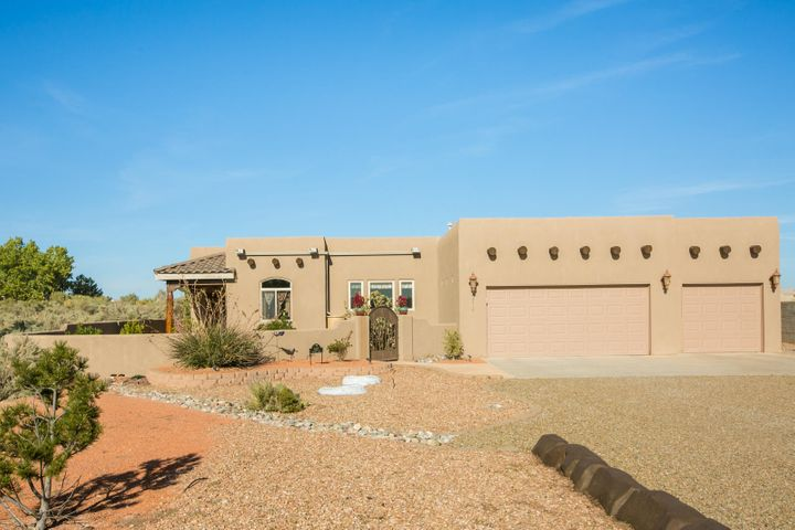 You won't want to miss this stunning one level custom home on .50 acre view lot! Original Owners didn't miss a detail when building this home. Nice open floor plan,  windows with amazing views of the Sandias. 3brm/2bath/3 Car garage. Beamed T&G Ceilings, Refrigerated Air, Central Heating & Radiant Heating. Surround Sound, putting green and gorgeous landscaping with two fountains.This one will go FAST!