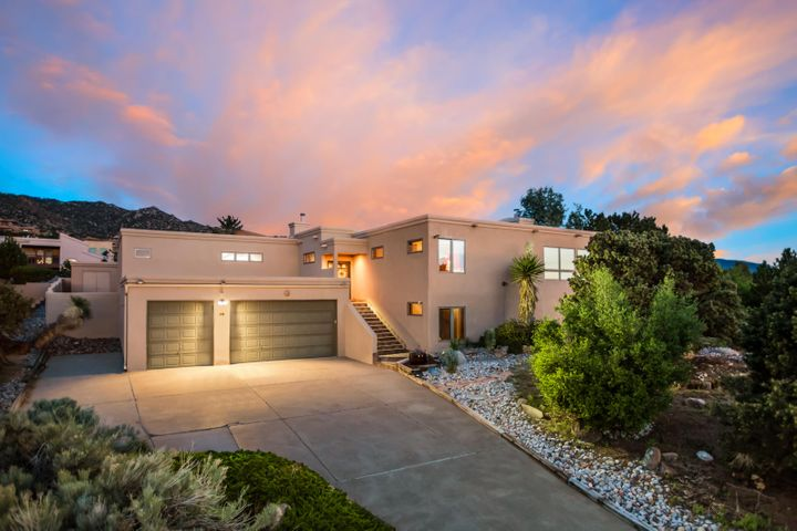 Great family custom SANDIA HEIGHTS home! Enter the house and AMAZING CITY VIEWS await you in the living room. Light and bright family room with a wood stove has clerestory windows angled on the ceiling for stunning VIEW OF SANDIA MOUNTAINS and ALBUQUERQUE SKY! Updated kitchen opens to living room, family room and dining room. Master bedroom with CITY VIEWS has a spa like bathroom. You will also find 3 large bedrooms on the main floor. Downstairs has 1 more bedroom, a rec. room, a study, and a home theater. 4 car garage offers a big workshop. This 500sqft workshop is not included in 5639 of living square footage. New Advanced Septic System, The Roof is Under Warranty (Until 2024-Transferable), and more!