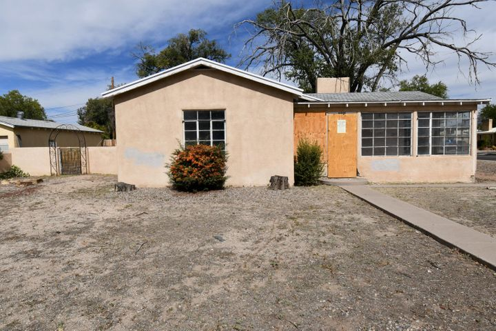 Great location on this desirable home. Could be considered UNM area as it is in close proximity to the university. This property features 3 slightly larger than usual bedrooms,  the owners suite has a full bath and small walk-in- closet, a huge living room with wood burning fireplace, an open eat in  kitchen with lots of natural light, 2 full baths, and beautiful hard wood floors in all living areas.  All of this  on a corner lot with easy access to  all your everyday needs.