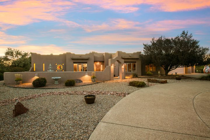 Custom single level home by Spencer Wood in lovely Berry Hill Farms. Gated 1.6 acre lot, fully and immaculately landscaped. Iconic southwest features including raised T&G ceilings with vigas, kiva fireplaces & exposed adobe. Unbelievable Master suite! Quality materials like Pella windows and custom cabinetry throughout. HUGE cooks kitchen with granite counters, island, Viking stove with double ovens. Kitchen overlooks gorgeous back yard. Beautifully designed floorplan for many interests including up to 5 bdrms, heated & cooled shop with 30 amps + 110 ,bthrm & garage door . 4-5 car garage or 2 plus RV garage with plug & access to sewer dump. Radiant heater plus 2 refrigerated cooling units. Large shed. horseshoe pit. Amazing portal with fireplace and banco. This home is amazing!  SEE LOSO
