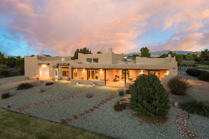 Custom single level home by Spencer Wood in lovely Berry Hill Farms. Gated 1.6 acre lot, fully & immaculately landscaped. Iconic southwest features including raised T&G ceilings w/vigas, kiva fireplaces & exposed adobe. Unbelievable Master suite! Quality materials T/O - Pella windows & custom cabinetry. HUGE cooks kitchen w/granite counters, island, Viking stove & double ovens. Kitchen overlooks gorgeous back yard. Beautifully designed floorplan for many interests including up to 5 bdrms. Heated & cooled shop with 30 amps + 110 ,bthrm, air hose & garage door . 4-6 car garage if you use shop or 2 plus RV garage w/plug & access to sewer dump. Radiant heat plus 2 refrigerated cooling units. Large shed. Horseshoe pit. Amazing portal with fireplace and banco. This home is amazing!  SEE LOSO