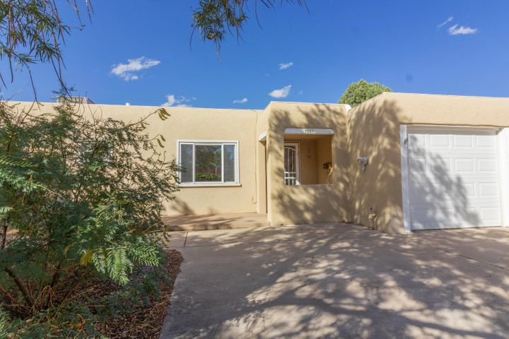 Beautifully maintained and updated 3 bedroom, 3 bath UNM North area home. Amazing art studio, craft room, home office, or 4th bedroom with a soaring ceiling and tons of natural light!  Just a short walk to the UNM campus.   Light and bright, this home had a wonderful addition added on in 2008 featuring a master suite with a large walk in closet and a beautifully designed master bathroom with in floor radiant heat. Great kitchen opens up to the oversized dining area with an Anderson sliding door leading out to your gorgeous backyard with a private covered patio.  Refrigerated air. Great location!  Great updates!  This is truly a one of kind home!