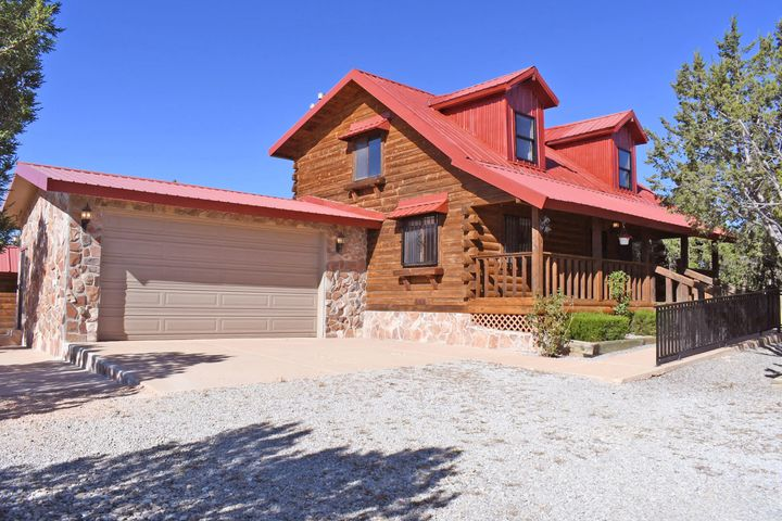 **OPEN HOUSE SAT 10/26 Noon-2pm**  Exceptional property. Log home on almost two and a half secluded acres at the end of a private road, yet close-in Edgewood. Metal roof, two car garage, covered porches, large fenced yard. Community water. Don't miss out!
