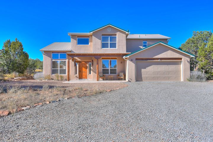 **OPEN HOUSE SATURDAY, Nov, 16TH 12AM-3PM**  Gorgeous Sandia Park home located on over an acre! This 3 bedroom comes with a bonus room and is filled with hand-scraped maple and 3/4'' plank read oak floors. This home is well insulated with 2x6 framing. Owned 2.6KW solar panel owned and transferable to receive payments from PNM. Very well maintained home re-stuccoed in 2012. Air conditioning system and ducting replaced in 2018, rear patio columns replaced in 2018, Radiant floor heating included and sooo much more! Don't wait to see this dream home and it's gorgeous surrounding. Quick distance to Albuquerque, 1.7 miles to Pakko Ridge Golf Club, and 10 miles to Sandia Peak Ski & Tram! Schedule a tour to see this home an make it yours!