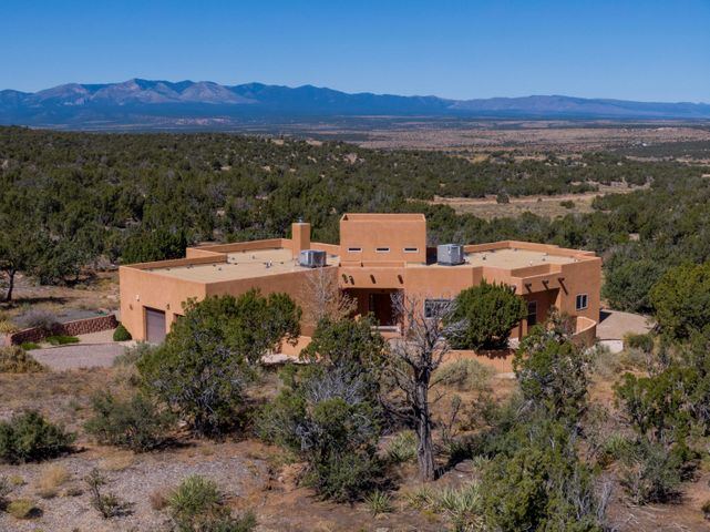 Welcome to Deer Canyon Preserve with over 11,000 acres sitting on the Chupadera Mesa. This gated community have views of the Manzano Mountains. A very private community with equestrian and hiking trails. 16 foot ceiling in the living room complete with a fireplace. The kitchen boasts Maple cabinets, a walk in pantry and breakfast bar. There is Jeldwyn windows, porcelain tile floors, Jack and Jill bathroom, a study and covered back patio with a ceiling fan. If your looking for a quiet private community look no further. Approximately 60 minutes to Albuquerque and 90 minutes to Santa Fe.